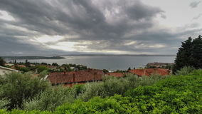 Thunderstorm and cloudscape above sea bay in daylight, panoramic view. Time lapse. Stock Images