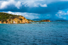Thunderstorm of the Coast of St. Thomas. Rock formation in Caribbean Sea off the cost of St. Thomas in the Virgin Islands.  Thunderstorm moving in on the right Stock Image