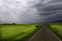 Thunderstorm and country road Stock Photos