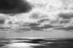 Thunderstorm with dark clouds over the ocean Royalty Free Stock Images