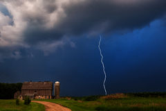 Thunderstorm on the Farm. Lightning descends from the clouds Stock Photo