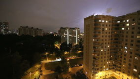Thunderstorm flashes and lightning over the city, in night sky background. Moscow, Russia stock video