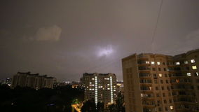 Thunderstorm flashes and lightning over the city, in night sky background. Moscow, Russia stock footage