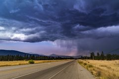 Thunderstorm heavy dark blue sky with clouds hard rain in the horizon Royalty Free Stock Images