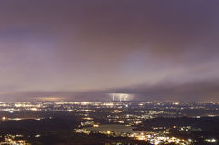 Thunderstorm at the horizon. City of Varese in the night and thunderstorm at the horizon stock photos