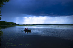 The thunderstorm on a lake royalty free stock photos