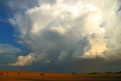 Thunderstorm. Large thunderstorm cloud rises above the landscape Royalty Free Stock Photos