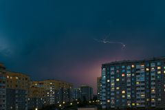 Thunderstorm with Lightning bolt strike over city. Moment lightning royalty free stock image