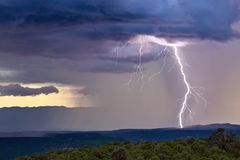 Thunderstorm with lightning bolt. Strike, dark storm clouds, and heavy rain stock images