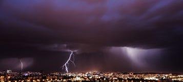 Thunderstorm lightning city glow clouds stock image
