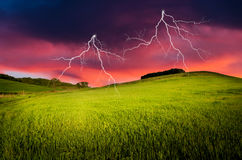 Thunderstorm. With lightning in green meadow Stock Photography