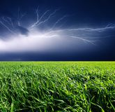 Thunderstorm. With lightning in green meadow. Dark ominous clouds Stock Photos
