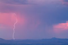 Thunderstorm and lightning. Thunderstorm with lightning and heavy rainclouds at sunset Royalty Free Stock Image