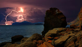 Thunderstorm and lightning on the hills, Crimea. Lightning over the coast of the Black sea. Rocky coast of the Eastern Crimea. Near Koktebel. The power and stock photography