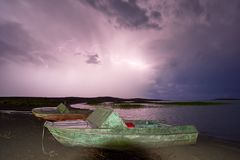 Thunderstorm with lightning on the lake. Thunderstorm with lightning on Lake Balkhash Stock Photos