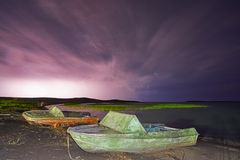 Thunderstorm with lightning on the lake. Thunderstorm with lightning on Lake Balkhash Royalty Free Stock Image