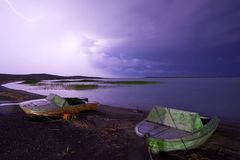 Thunderstorm with lightning on the lake. Thunderstorm with lightning on Lake Balkhash Royalty Free Stock Photo