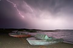 Thunderstorm with lightning on the lake. Stock Photo
