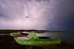 Thunderstorm with lightning on the lake. Royalty Free Stock Photo