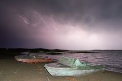 Thunderstorm with lightning on the lake. Thunderstorm with lightning on Lake Balkhash Royalty Free Stock Images