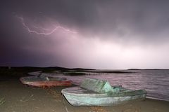 Thunderstorm with lightning on the lake. Thunderstorm with lightning on Lake Balkhash Stock Photo