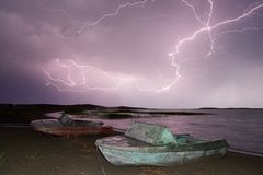 Thunderstorm with lightning on the lake. Thunderstorm with lightning on Lake Balkhash Royalty Free Stock Photography
