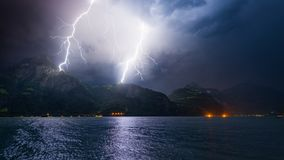 Thunderstorm with Lightning. Mountain landscape by storm and rain. Discharge of lightning strikes the top of the mountains stock images