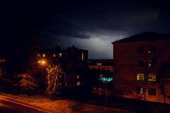 Thunderstorm with lightning over the houses at residential area at Moscow suburb Royalty Free Stock Photos