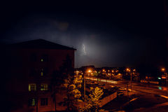 Thunderstorm with lightning over the houses at residential area at Moscow suburb Royalty Free Stock Images