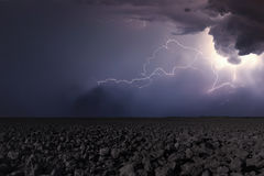 Thunderstorm with lightning in plowed field. Thunderstorm backgr Stock Images