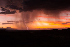 Thunderstorm and lightning strike at Sunset Royalty Free Stock Image