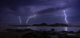 Thunderstorm on mediterranean sea beach. Lightning, heavy clouds and rain stormy weather stock photo