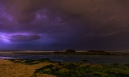 Thunderstorm on mediterranean sea beach. Lightning, heavy clouds and rain stormy weather stock photography