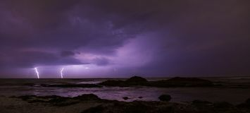 Thunderstorm on mediterranean sea beach. Lightning, heavy clouds and rain stormy weather royalty free stock photos