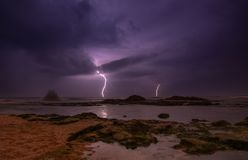 Thunderstorm on mediterranean sea beach. Lightning, heavy clouds and rain stormy weather stock photos
