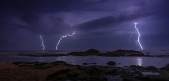 Thunderstorm on mediterranean sea beach. Lightning, heavy clouds and rain stormy weather stock image