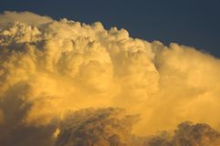 Thunderstorm moving in at sunset. A thunderstorm moves into over a midwest town at sunset royalty free stock photography