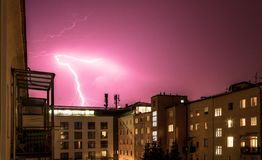 Thunderstorm in the night: Lightning on the sky, urban city, Austria. Lightning on the cloudy sky, urban city life with buildings, Austria thunderstorm energy royalty free stock photography
