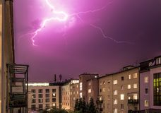 Thunderstorm in the night: Lightning on the sky, urban city,. Lightning on the cloudy sky, urban city life with buildings,  thunderstorm energy electricity stock images