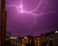 Thunderstorm in the night: Lightning on the sky, urban city,. Lightning on the cloudy sky, urban city life with buildings,  thunderstorm energy electricity royalty free stock images