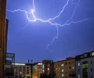 Thunderstorm in the night: Lightning on the sky, urban city, Austria. Lightning on the cloudy sky, urban city life with buildings, Austria thunderstorm energy royalty free stock image