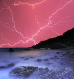 Thunderstorm in the ocean. Beach Stock Photos