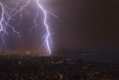 Thunderstorm over the city Stock Photos