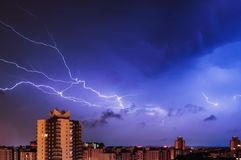 Thunderstorm over the city at night. Lightning, thunder and dramatic sky Stock Images