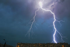 Thunderstorm over the city. Thunderstorm over the city a strong lightning discharge Royalty Free Stock Photo