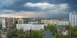 Thunderstorm over city. View of the city from roof of high-rise buildings at beginning of a thunderstorm Stock Photo