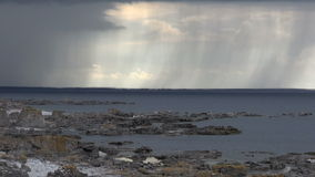 Thunderstorm over coast and ocean at faro - Sweden Royalty Free Stock Images