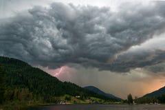 Thunderstorm over lake. Dramatic thunderstorm with lightning over Schwarzsee lake in Kitzbuhel, Austria Stock Image