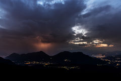 Thunderstorm over mountains at the horizon Royalty Free Stock Images