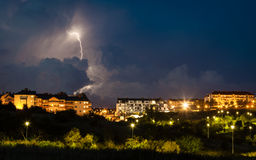 Thunderstorm over night city Stock Photo